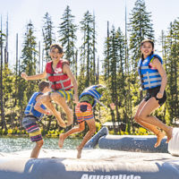 Kids jumping on a water trampoline
